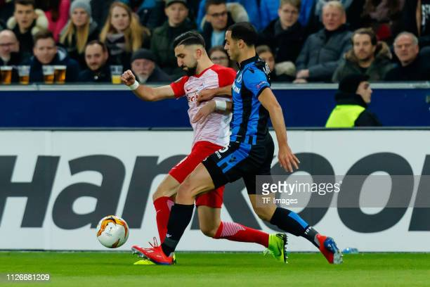 Munas Dabbur of RB Salzburg and Sofyan Amrabat of Club Brugge battle for the ball during the UEFA Europa League Round of 32 Second Leg match between...