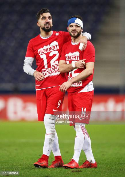 Munas Dabbur of Red Bull Salzburg and Valon Berisha of Red Bull Salzburg celebrate victory after the UEFA Europa League group I match between FC...