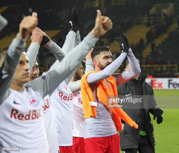 Munas Dabbur of Red Bull Salzburg celebrate victory after the UEFA Europa League Round of 16 match between Borussia Dortmund and FC Red Bull Salzburg...