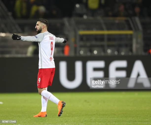 Munas Dabbur of Red Bull Salzburg celebrates victory after the UEFA Europa League Round of 16 match between Borussia Dortmund and FC Red Bull...