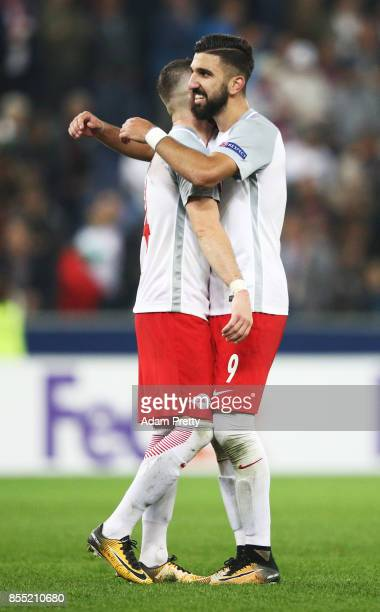 Munas Dabbur of Red Bull Salzburg celebrates victory with Valon Berisha after the UEFA Europa League group I match between RB Salzburg and Olympique...