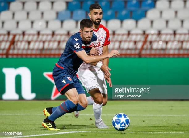 Munas Dabbur of Red Bull Salzburg in action against Milos Degenek of Crvena Zvezda during the UEFA Champions League Play Off First Leg match between...