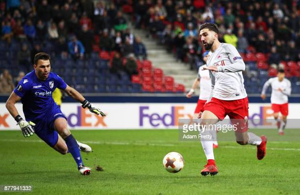 Munas Dabbur of Red Bull Salzburg runs around Douglas of Vitoria Guimaraes to set up a goal during the UEFA Europa League group I match between FC...