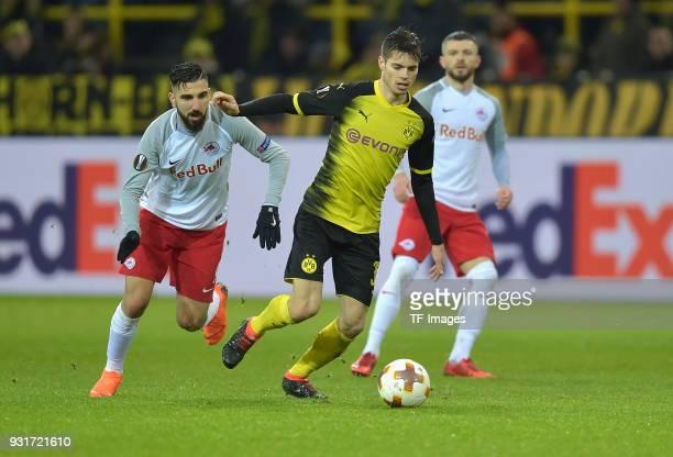Munas Dabbur of Salzburg and Julian Weigl of Dortmund battle for the ball during UEFA Europa League Round of 16 match between Borussia Dortmund and...