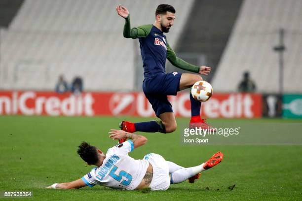 Munas Dabbur of Salzburg and Lucas Ocampos of Marseille during the Uefa Europa League match between Olympique de Marseille and Red Bull Salzburg at...
