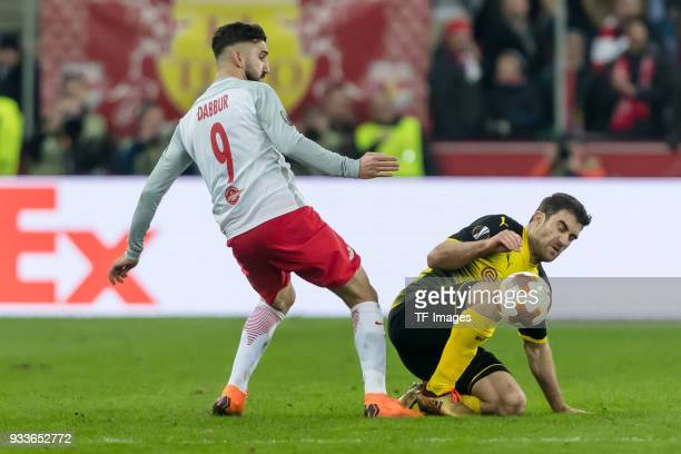 Munas Dabbur of Salzburg and Sokratis of Dortmund battle for the ball during UEFA Europa League Round of 16 second leg match between FC Red Bull...