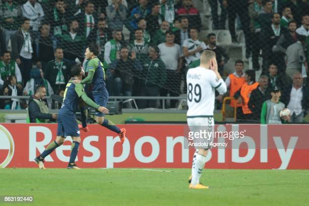 Munas Dabbur of Salzburg celebrates with his teammate Takumi Minamino after scoring during the UEFA Europa League Group I soccer match between Atiker...