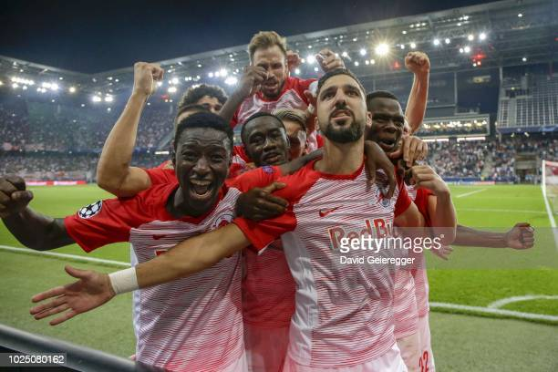 Munas Dabbur of Salzburg celebrates with his teammates after scoring the second goal during the UEFA Champions League match between FC Salzburg and...