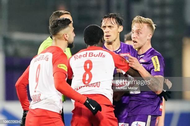 Munas Dabbur of Salzburg Diadie Samassekou of Salzburg and James Jeggo of Austria Wien react during the tipico Bundesliga match between Austria Wien...