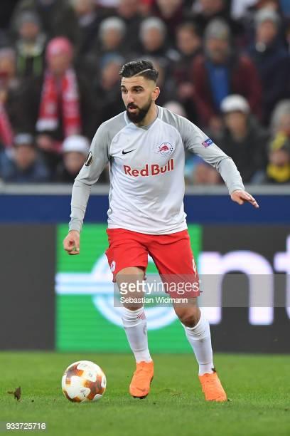 Munas Dabbur of Salzburg plays the ball during the UEFA Europa League Round of 16 2nd leg match between FC Red Bull Salzburg and Borussia Dortmund at...