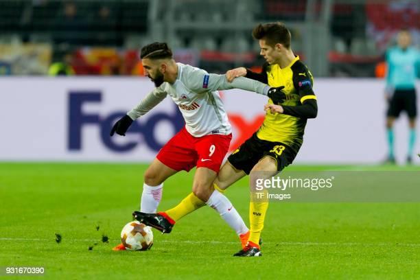 Munas Dabbur of Salzburg und Julian Weigl of Dortmund battle for the ball during the UEFA Europa League Round of 16 match between Borussia Dortmund...