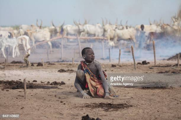 Mundari child covered his face and body with ash to protect himself from insects and mosquitos is seen in Terekeka town of Juba South Sudan on...