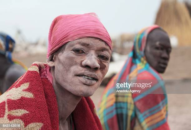 Mundari man covered his face and body with ash to protect himself from insects and mosquitos is seen in Terekeka town of Juba South Sudan on February...