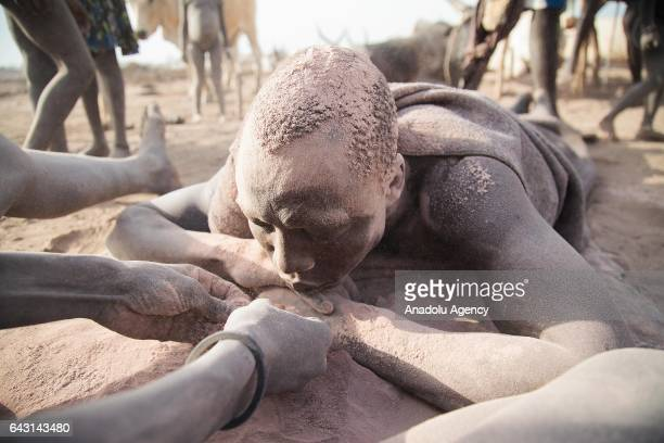 Mundari man covers his face and body with ash to protect himself from insects and mosquitos in Terekeka town of Juba South Sudan on February 9 2017...
