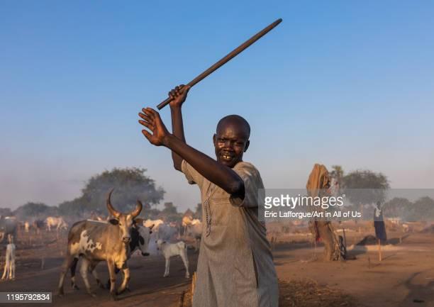 Mundari man fighting with the traditional stick Central Equatoria Terekeka South Sudan on November 16 2019 in Terekeka South Sudan