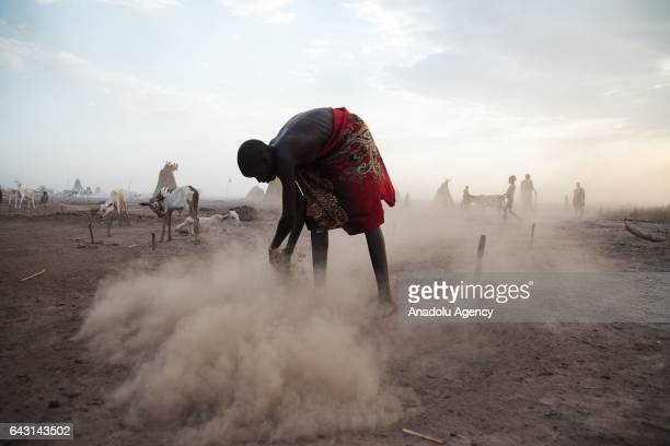 Mundari man is seen with AnkoleWatusi cattles in Terekeka town of Juba South Sudan on February 9 2017 Munda people a small ethnic group of South...