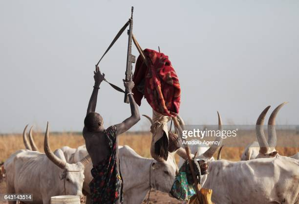 Mundari man is seen with his weapon in Terekeka town of Juba, South Sudan on February 9, 2017. Munda people, a small ethnic group of South Sudan,...