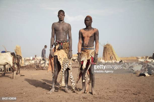 Mundari men are seen with their traditional costumes in Terekeka town of Juba South Sudan on February 9 2017 Munda people a small ethnic group of...