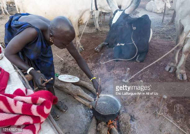 Mundari tribe woman roasting coffee in a cattle camp Central Equatoria Terekeka South Sudan on February 12 2020 in Terekeka South Sudan
