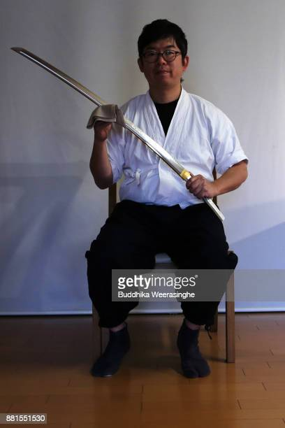 Munehiro Myochin holds one of his newly made sword plates at his workshop on November 29 2017 in Himeji Japan The history of the traditional Japanese...