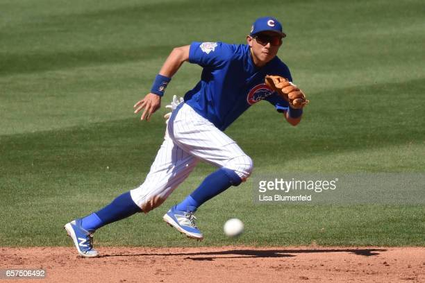 Munenori Kawasaki of the Chicago Cubs attempts to field the ball in the fifth inning during the game against the Cleveland Indians during a spring...