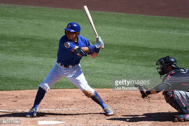 Munenori Kawasaki of the Chicago Cubs bats in the fifth inning during the spring training game against the Cleveland Indians during a spring training...
