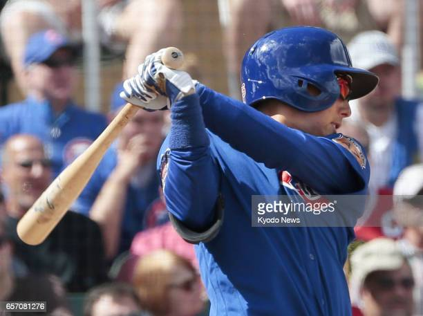Munenori Kawasaki of the Chicago Cubs doubles during the fifth inning of a spring training game against the Arizona Diamondbacks in Scottsdale...