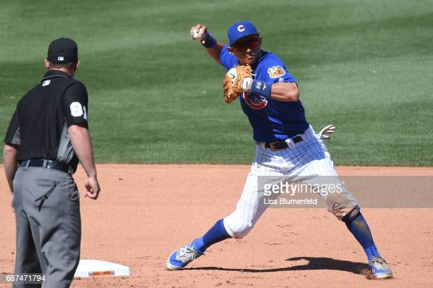 Munenori Kawasaki of the Chicago Cubs fields the ball in the fifth inning during the game against the Cleveland Indians during a spring training game...