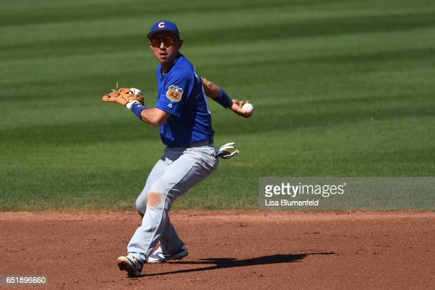 Munenori Kawasaki of the Chicago Cubs fields the ball in the fourth inning against the Seattle Mariners at Peoria Stadium on March 10 2017 in Peoria...
