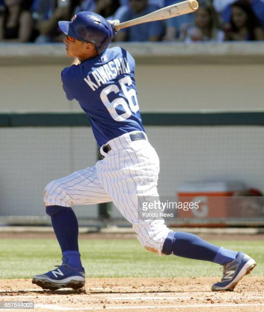Munenori Kawasaki of the Chicago Cubs hits a triple during the second inning of the team's 42 spring training game loss to the Cleveland Indians in...