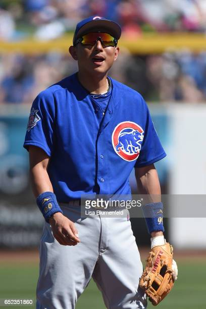 Munenori Kawasaki of the Chicago Cubs plays shortstop in the third inning against the Seattle Mariners at Peoria Stadium on March 10 2017 in Peoria...