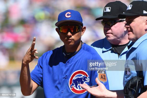 Munenori Kawasaki of the Chicago Cubs presents the line up card at the pregame plate meeting before the game against against the Seattle Mariners...