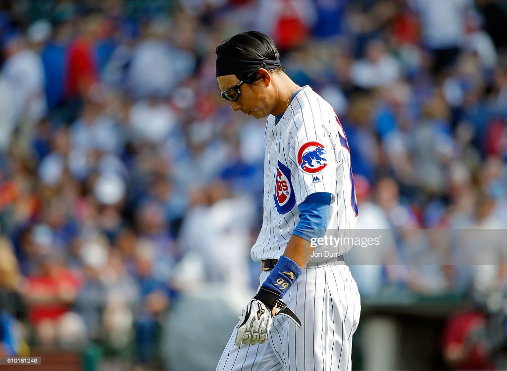 Munenori Kawasaki #66 of the Chicago Cubs reacts after striking out against the St. Louis Cardinals to end the eighth inning at Wrigley Field on September 24, 2016 in Chicago, Illinois. The St. Louis Cardinals won 10-4.