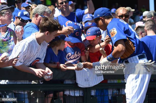 Munenori Kawasaki of the Chicago Cubs signs autographs before the game against the Cleveland Indians at Sloan Park on March 24 2017 in Mesa Arizona