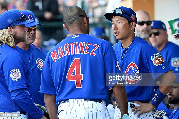 Munenori Kawasaki of the Chicago Cubs talks with bench coach Dave Martinez in the sixth inning against the Cleveland Indians at Sloan Park on March 9...