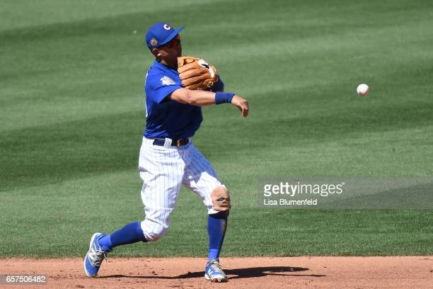 Munenori Kawasaki of the Chicago Cubs throws the ball to first base in the fifth inning during the game against the Cleveland Indians during a spring...