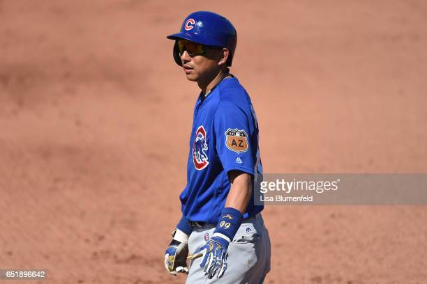 Munenori Kawasaki of the Chicago Cubs waits at first base after hitting a single in the fifth inning against the Seattle Mariners at Peoria Stadium...
