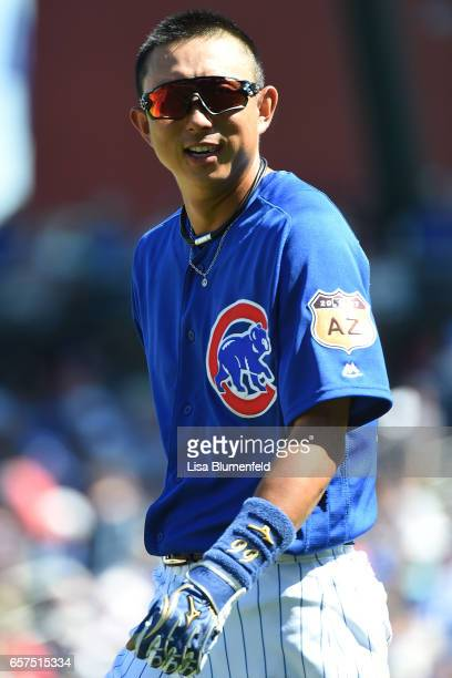 Munenori Kawasaki of the Chicago Cubs walks along the field at the end of the second inning against the Cleveland Indians during a spring training...