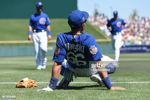 Munenori Kawasaki of the Chicago Cubs warms up before the game against the Cleveland Indians during a spring training game on March 24 2017 in Mesa...