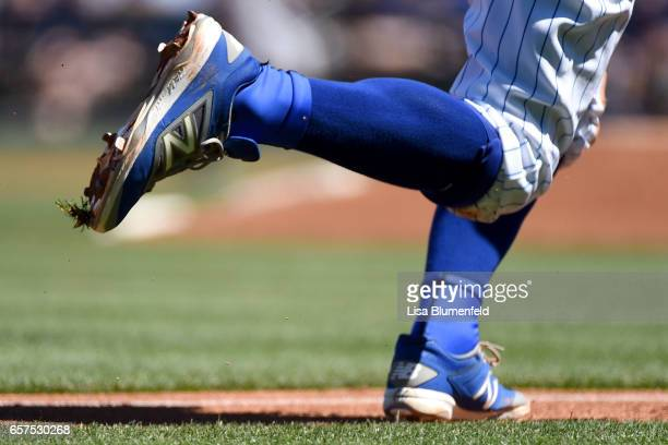 Munenori Kawasaki of the Chicago Cubs wears New Balance shoes during the game against the Cleveland Indians during a spring training game on March 24...
