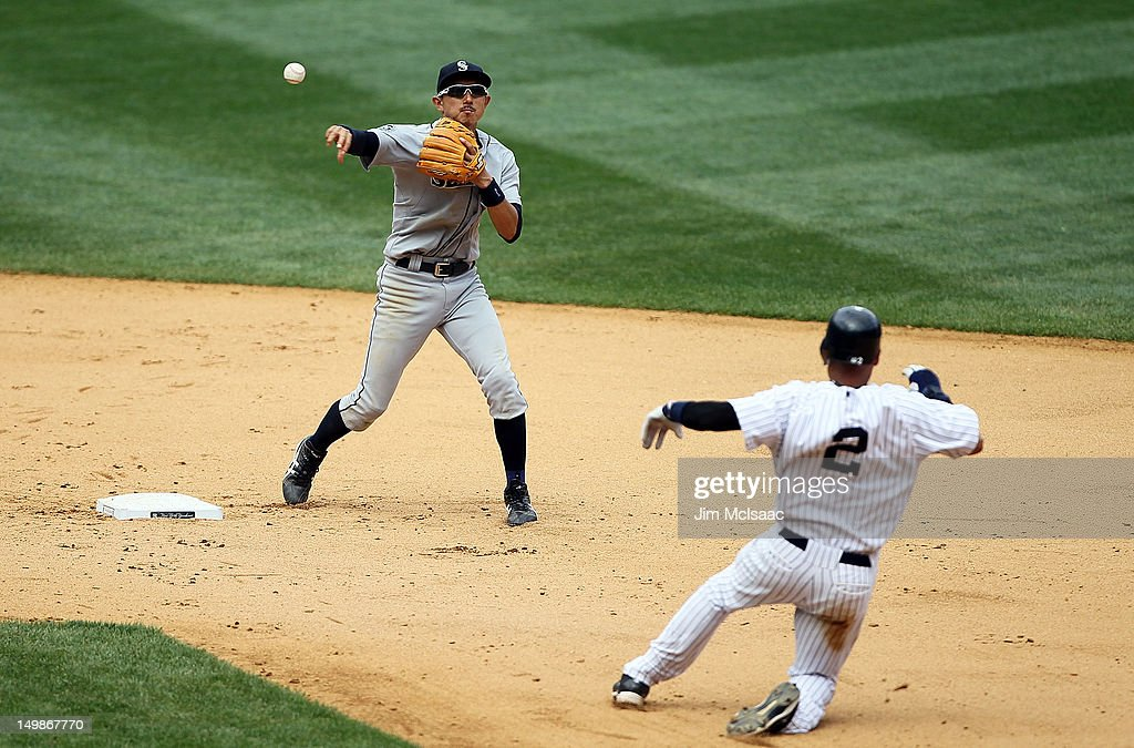 Munenori Kawasaki #61 of the Seattle Mariners throws to first base to complete an eighth inning double play after forcing out Derek Jeter #2 of the New York Yankees at Yankee Stadium on August 5, 2012 in the Bronx borough of New York City.