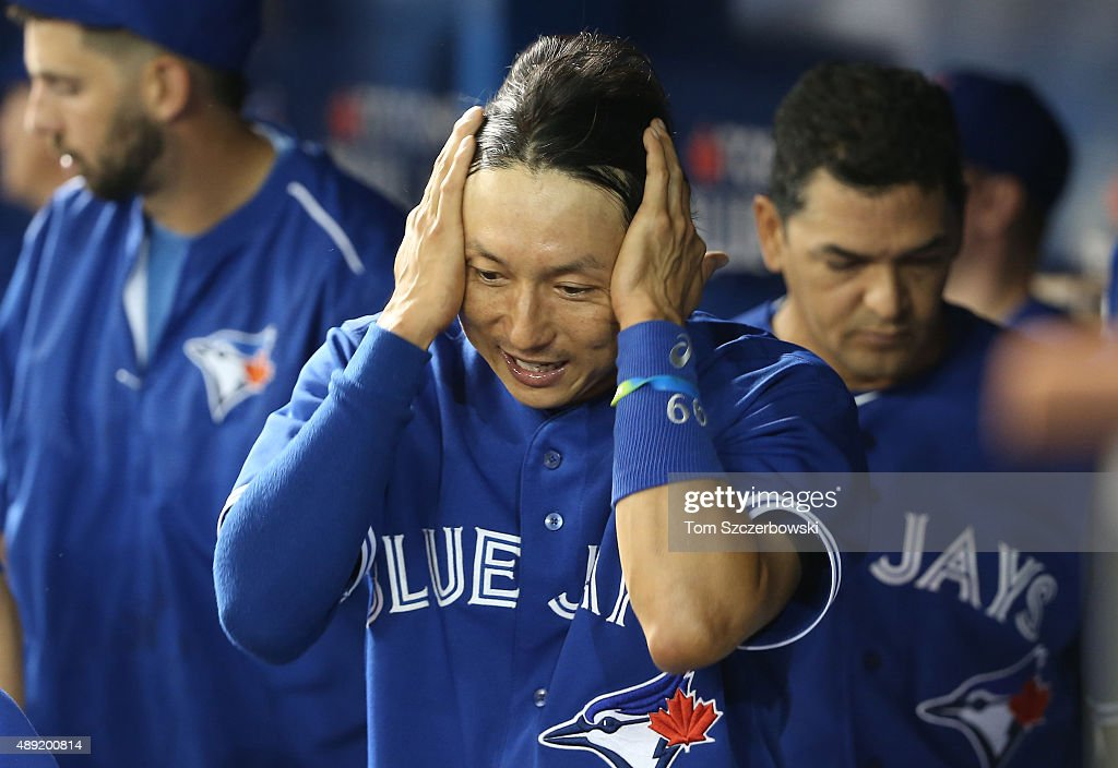 Munenori Kawasaki #66 of the Toronto Blue Jays after pinch-running at the end of the eighth inning during MLB game action against the Boston Red Sox on September 19, 2015 at Rogers Centre in Toronto, Ontario, Canada.