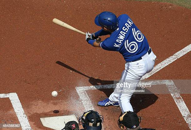 Munenori Kawasaki of the Toronto Blue Jays bats in the first inning during MLB game action against the New York Yankees on August 30 2014 at Rogers...