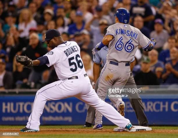 Munenori Kawasaki of the Toronto Blue Jays beats out a single in the ninth inning against closing pitcher Fernando Rodney of the Seattle Mariners at...
