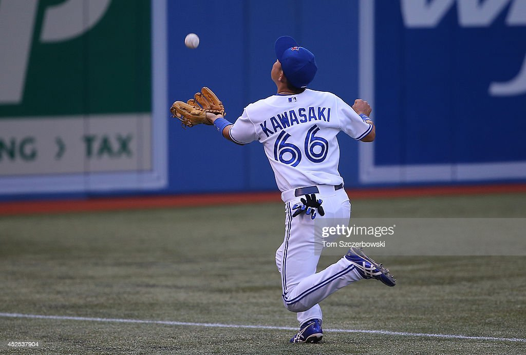 Munenori Kawasaki #66 of the Toronto Blue Jays catches a foul pop up in the second inning during MLB game action against the Boston Red Sox on July 22, 2014 at Rogers Centre in Toronto, Ontario, Canada.