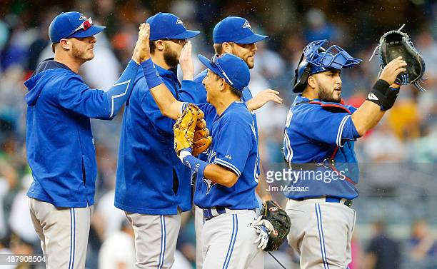 Munenori Kawasaki of the Toronto Blue Jays celebrates with his teammates after defeating the New York Yankees at Yankee Stadium on September 12 2015...