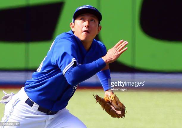 Munenori Kawasaki of the Toronto Blue Jays chases a pop fly in the 8th inning against the Tampa Bay Rays during MLB action at the Rogers Centre...