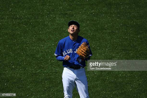 Munenori Kawasaki of the Toronto Blue Jays checks the light as he looks up at the sun in the eighth inning during MLB game action against the Seattle...