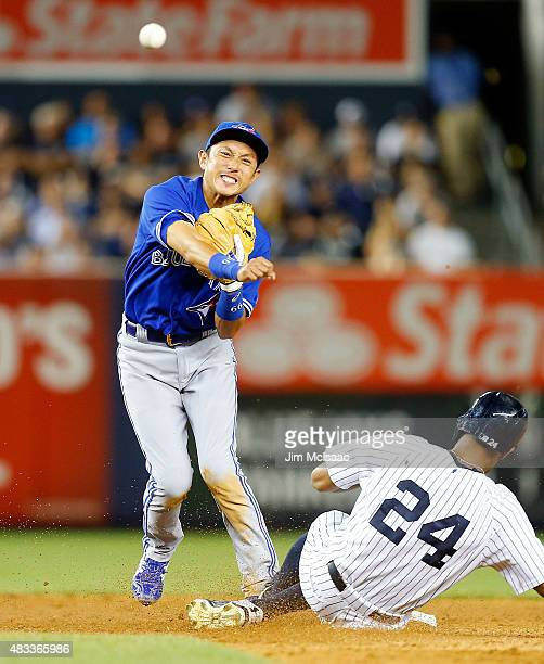 Munenori Kawasaki of the Toronto Blue Jays completes a ninth inning double play after forcing out Chris Young of the New York Yankees at Yankee...