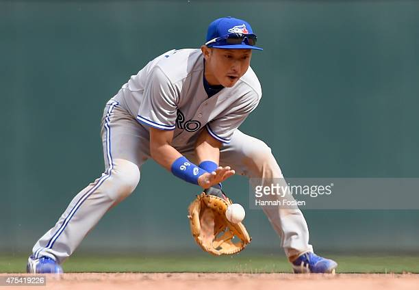 Munenori Kawasaki of the Toronto Blue Jays fields the ball hit by Eduardo Nunez of the Minnesota Twins at second base during the eighth inning of the...